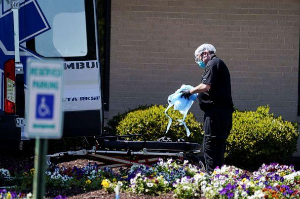 PHOTO: An ambulance worker is seen outside the Canterbury Rehabilitation & Healthcare Center in Richmond, Va., April 16, 2020. (Kevin Lamarque/Reuters, FILE)
