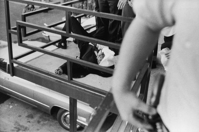 <p>A view of the partially covered body of slain civil rights leader Dr. Martin Luther King, Jr., on the balcony of the Lorraine Motel. (Photo: Joseph Louw/The LIFE Images Collection/Getty Images) </p>