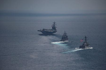 The aircraft carrier USS Carl Vinson leads USS Michael Murphy and USS Lake Champlain in the Indian Ocean