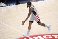 Washington Wizards guard Bradley Beal (3) gestures after he made a three-point basket during the second half of an NBA basketball game against the Charlotte Hornets, Sunday, May 16, 2021, in Washington. (AP Photo/Nick Wass)