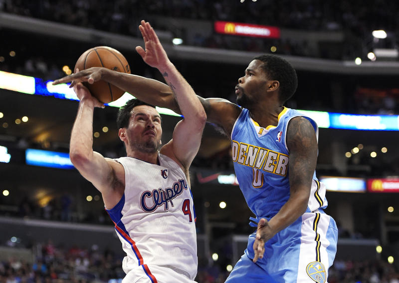 Los Angeles Clippers guard J.J. Redick, left, looks to shoot as Denver Nuggets guard Aaron Brooks defends during the first half of an NBA basketball game, Tuesday, April 15, 2014, in Los Angeles. (AP Photo/Mark J. Terrill)