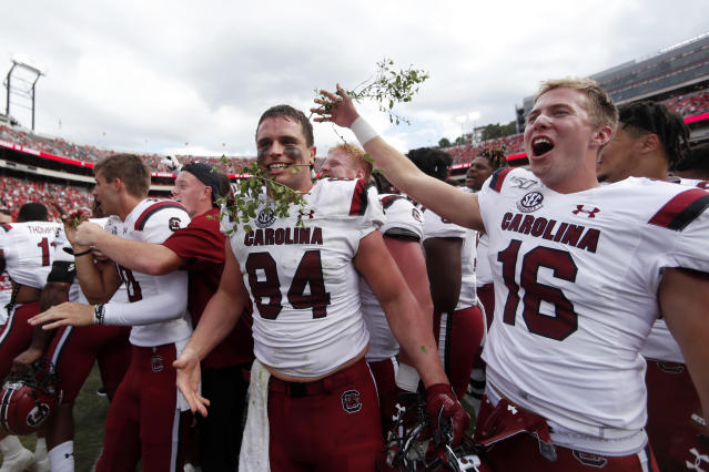 South Carolina's Kyle Markway (84) and Bailey Hart (16) celebrate after defeating Georgia 20-17 in double overtime of an NCAA college football game Saturday, Oct. 12, 2019, in Athens, Ga. (AP Photo/John Bazemore)