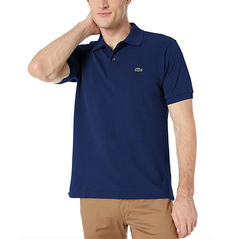 "<p><strong>Lacoste</strong></p><p>amazon.com</p><p><strong>$59.99</strong></p><p><a href=""https://www.amazon.com/dp/B000CDU5FK?tag=syn-yahoo-20&ascsubtag=%5Bartid%7C10054.g.32936561%5Bsrc%7Cyahoo-us"" rel=""nofollow noopener"" target=""_blank"" data-ylk=""slk:Buy"" class=""link rapid-noclick-resp"">Buy</a></p><p>A polo shirt from the brand that first made the polo shirt what it is today (a style everyone should own, naturally). </p>"