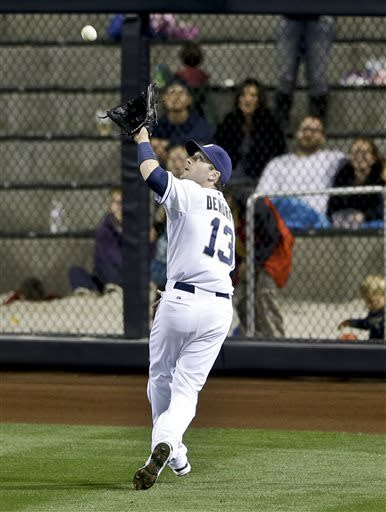 San Diego Padres right fielder Chris Denorfia makes the running catch just short of the warning track on a drive hit by Milwaukee Brewers' Ryan Braun in the sixth inning of a baseball game in San Diego, Wednesday, April 24, 2013. (AP photo/Lenny Ignelzi)