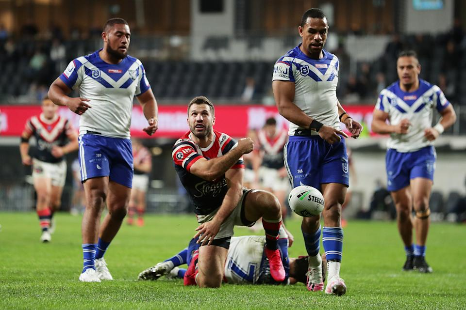 James Tedesco celebrates a try by throwing the ball.
