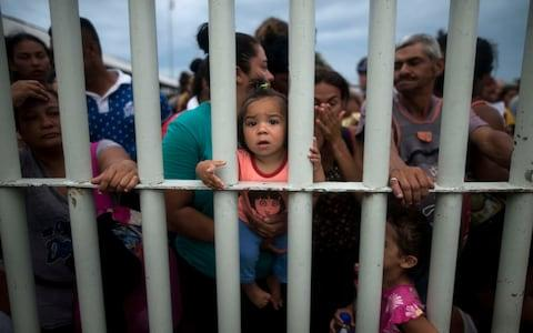 Around 200 were taken to a detention centre - thousands more remain on the bridge - Credit: AP