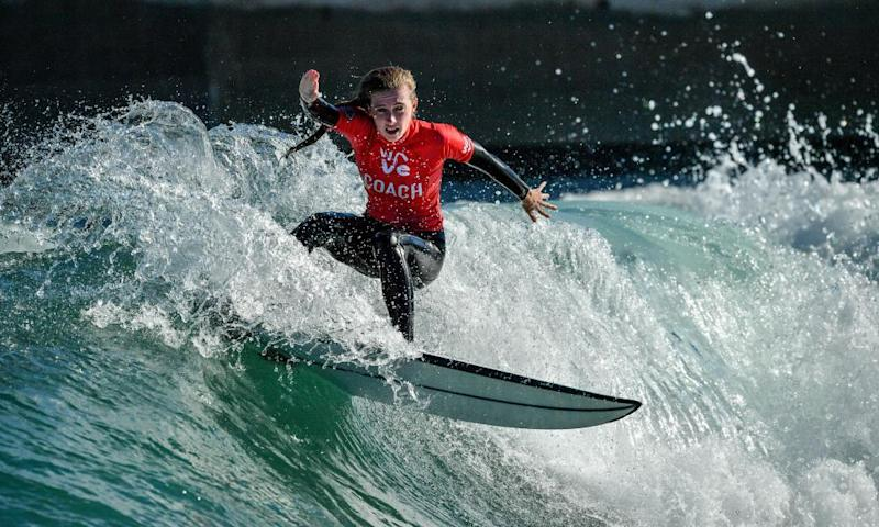 Staff member surfs a wave at The Wave, Bristol prior to it reopening to the public in August 2020.