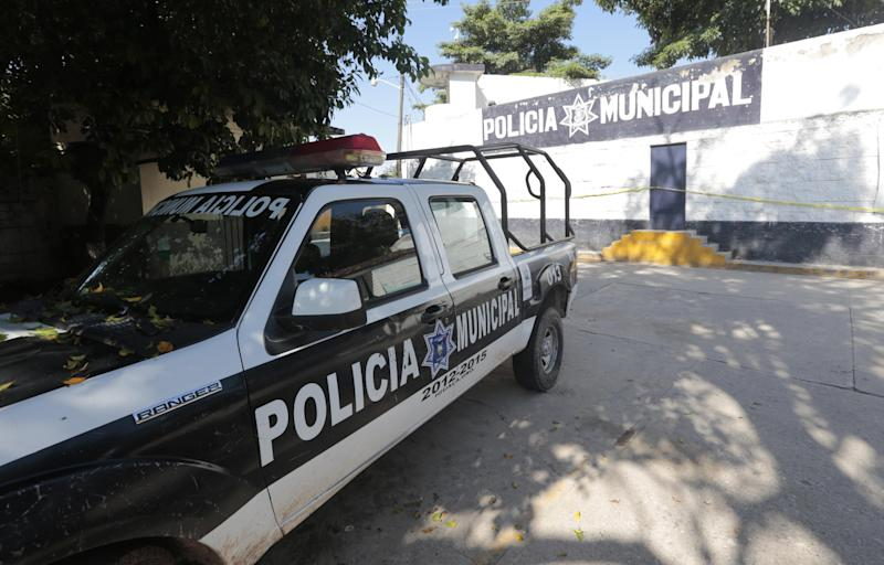 A police pickup is parked by the empty barracks of the Iguala municipal police, whose members were flagged as having collaborated with organized crime, October 6, 2014, in Guerrero state, Mexico