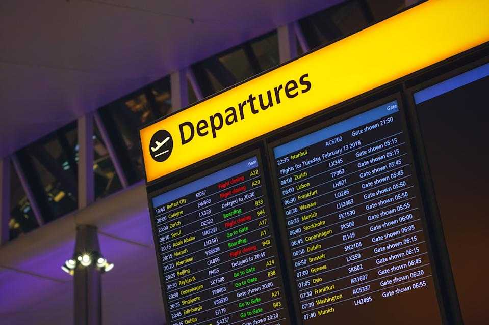 London, UK - August 12, 2018 - Departure board displaying time, destination cities and gate information in London Heathrow airport