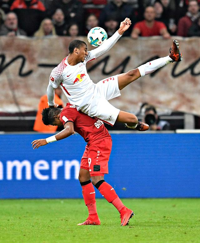 <p>Leipzig's Fernandes da Silva, up, and Leverkusen's Leon Bailey challenge for the ball during the German Bundesliga soccer match between Bayer Leverkusen and RB Leipzig in Leverkusen, Germany, Saturday, Nov. 18, 2017. (AP Photo/Martin Meissner) </p>