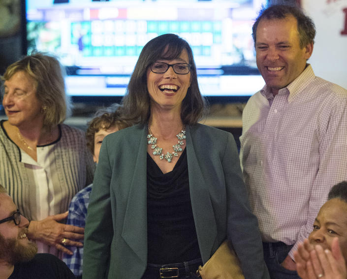 Surrounded by her family, Liz Watson, Democratic candidate for Indiana's Ninth District seat in the House of Representatives, meets applause from supporters in Bloomington after winning the primary. (Photo: Chris Howell/The Herald-Times via AP)