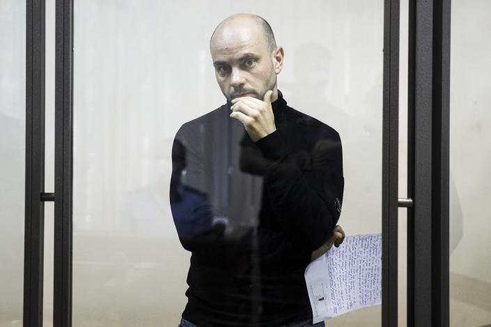 """Andrei Pivovarov, the head of Open Russia movement stands behind the glass during a court session in Krasnodar, Russia, Wednesday, June 2, 2021. In the southern city of Krasnodar, a court was scheduled to consider whether to keep Andrei Pivovarov, the head of the Open Russia movement, in custody pending an investigation. Pivovarov was pulled off a Warsaw-bound plane at St. Petersburg's airport just before takeoff late Monday and taken to Krasnodar, where authorities accused him of supporting a local election candidate last year on behalf of an """"undesirable"""" organization. (AP Photo)"""