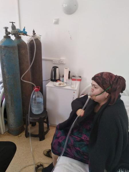 A patient receives oxygen support via a makeshift medical device at a local hospital in Dagestan's Gurbuki village