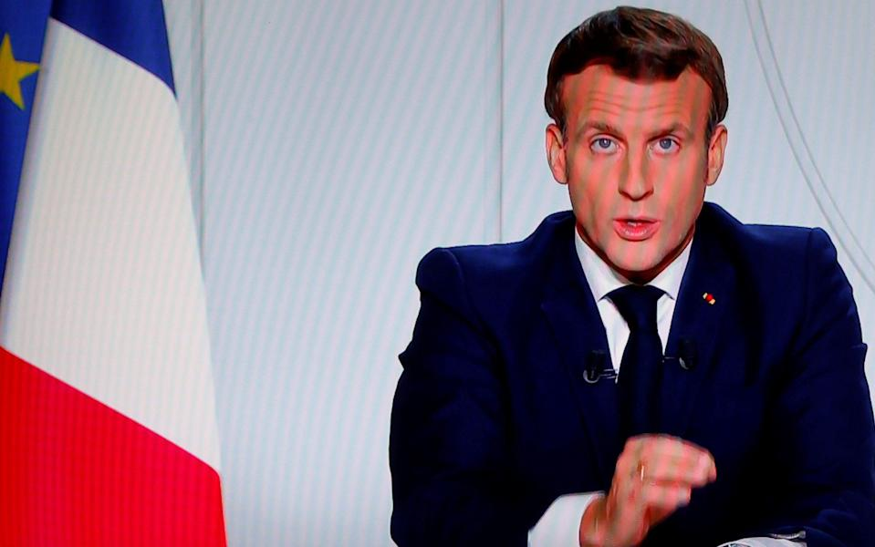 The French president, Emmanuel Macron, addresses the nation on television as he imposes a new lockdown - Christian Hartmann/Reuters