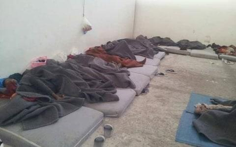 A mobile phone photograph showing the squalid conditions the detainees are held in - Credit: Sally Hayden