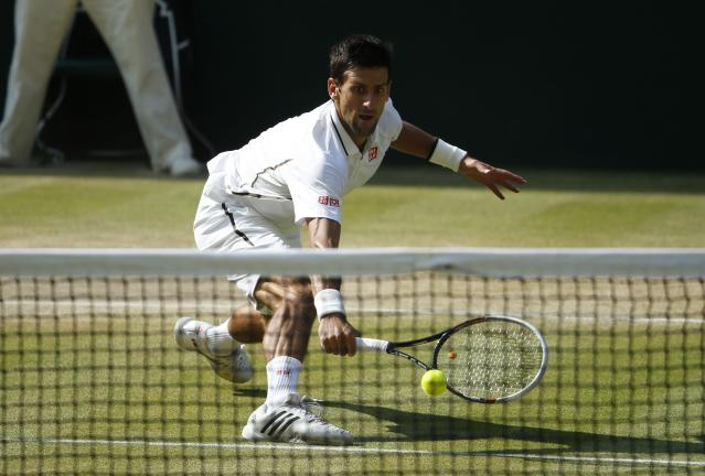 Serbia's Novak Djokovi in the Men's Final against Great Britain's Andy Murray during day thirteen of the Wimbledon Championships at The All England Lawn Tennis and Croquet Club, Wimbledon.