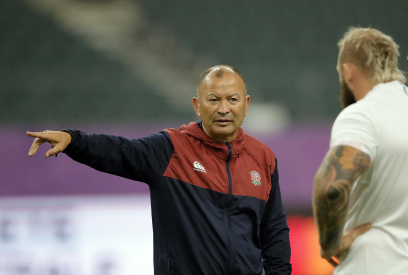 England's coach Eddie Jones speaks with Joe Marler during a training session in Oita, Japan, Friday, Oct. 18, 2019. England will face Australia in the quarterfinals at the Rugby World Cup on Oct. 19. (AP Photo/Christophe Ena)