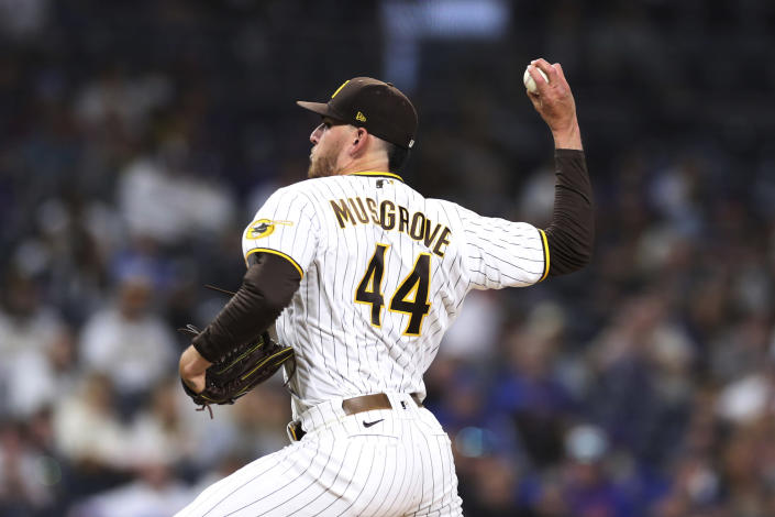 San Diego Padres starting pitcher Joe Musgrove delivers a pitch to a New York Mets batter during the fifth inning of a baseball game Saturday, June 5, 2021, in San Diego. (AP Photo/Derrick Tuskan)