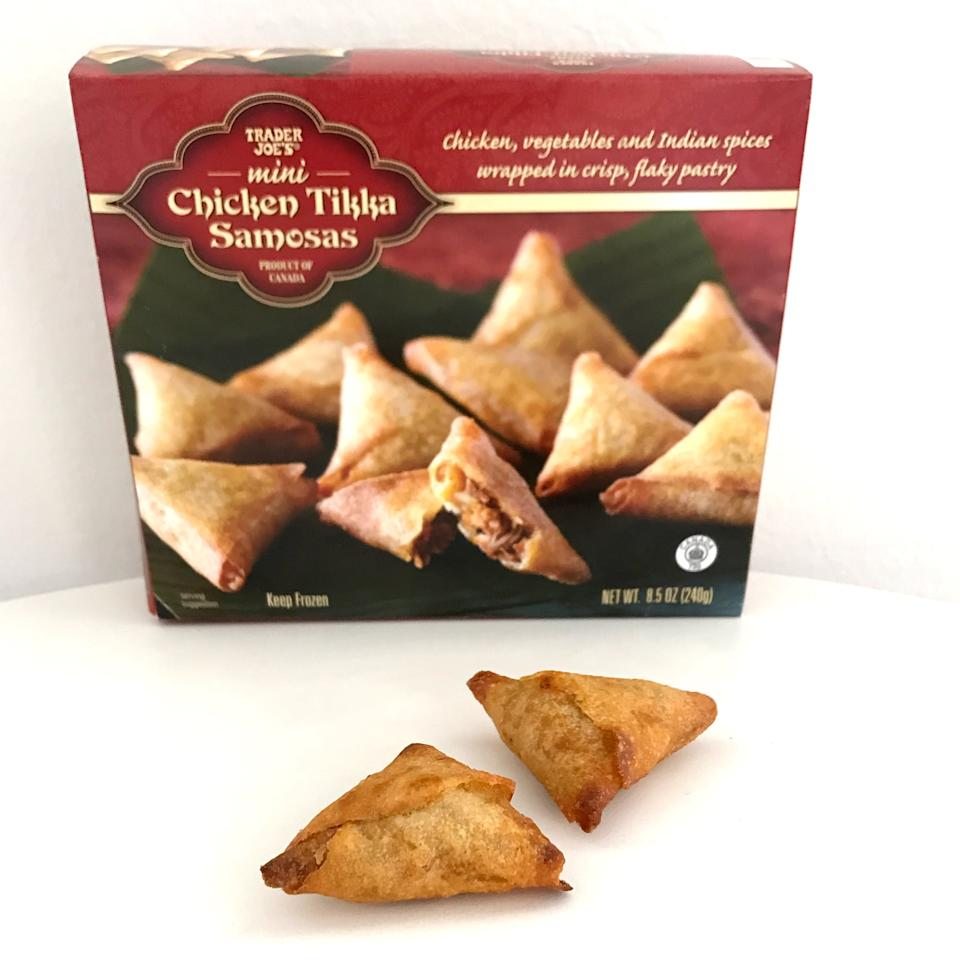 <p>Frozen samosas can be hit or miss, but Trader Joe's Chicken Tikka Samosas deserve a spot in your shopping cart for sure. Like little pockets of Trader Joe's Chicken Tikka Masala, one of our favorite entrees, these mini samosas are perfectly crispy, salty, and spicy. They get nice and golden brown in the oven, and the filling doesn't spill out of the sides.</p>