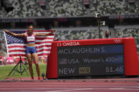 Gold medalist Sydney McLaughlin, of the United States, celebrates after winning the women's 400-meter hurdles at the 2020 Summer Olympics, Wednesday, Aug. 4, 2021, in Tokyo, Japan. (AP Photo/Petr David Josek)