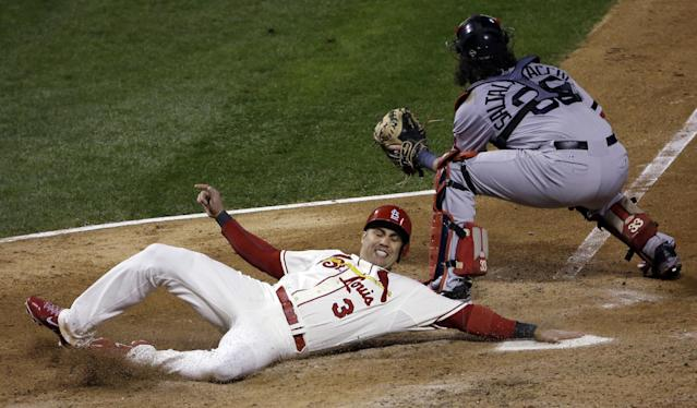 St. Louis Cardinals' Carlos Beltran slides safely past Boston Red Sox catcher Jarrod Saltalamacchia during the seventh inning of Game 3 of baseball's World Series Saturday, Oct. 26, 2013, in St. Louis. Beltran scored from second on a double by Matt Holliday. (AP Photo/David J. Phillip)