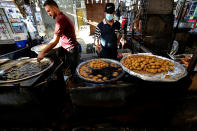 Street venders make traditional sweets at old Basra market, Iraq, Wednesday, Oct. 21, 2020. Iraq is in the throes of an unprecedented liquidity crisis, as the cash-strapped state wrestles to pay public sector salaries and import essential goods while oil prices remain dangerously low.(AP Photo/Nabil al-Jurani)