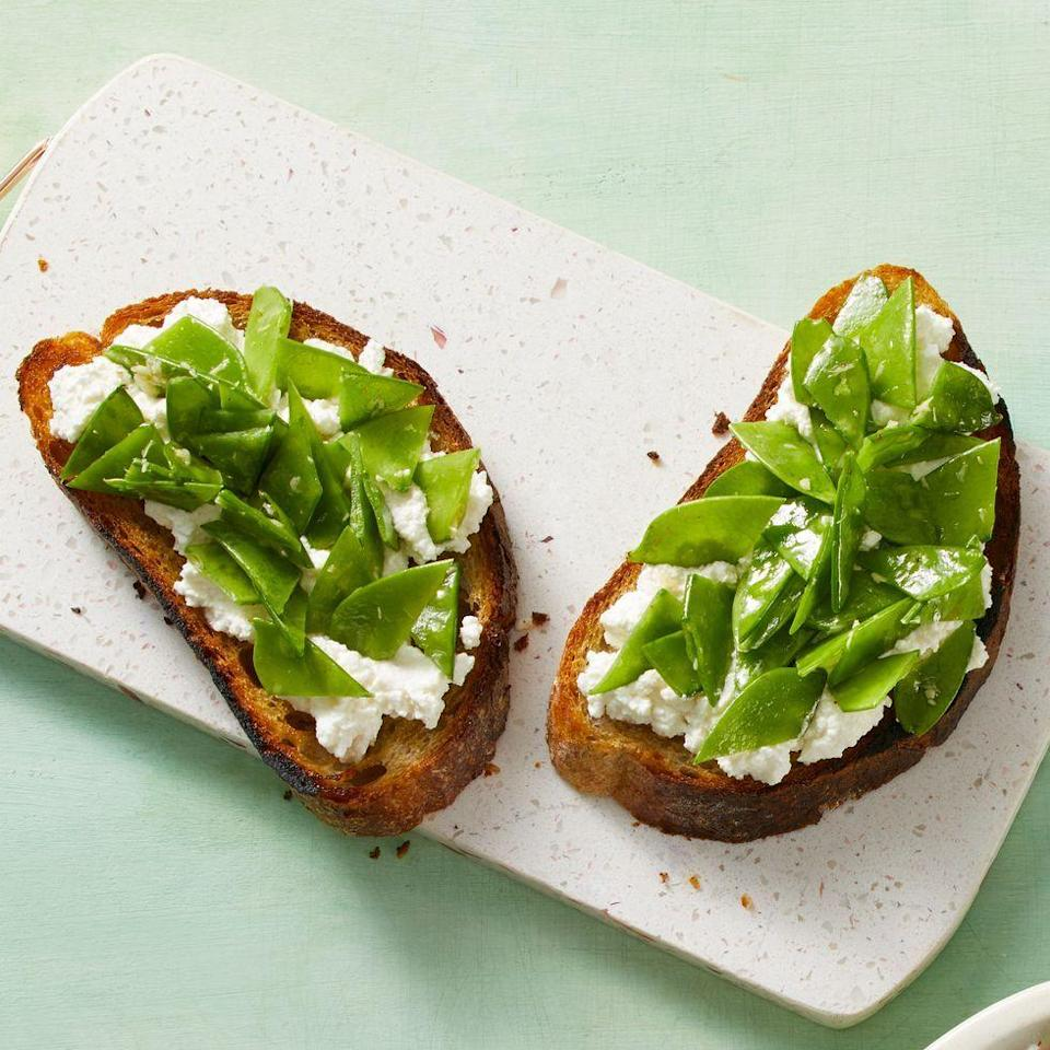 """<p>This recipe, just like the Mediterranean diet itself, places veggies front-and-center. In this case, snow peas provide plenty of fiber and folate, while ricotta and honey add a dash of sweetness.</p><p><a href=""""https://www.prevention.com/food-nutrition/recipes/a34079382/snow-pea-and-ricotta-toast-recipe/"""" rel=""""nofollow noopener"""" target=""""_blank"""" data-ylk=""""slk:Get the recipe from Prevention »"""" class=""""link rapid-noclick-resp""""><em><strong>Get the recipe from Prevention »</strong></em></a></p>"""