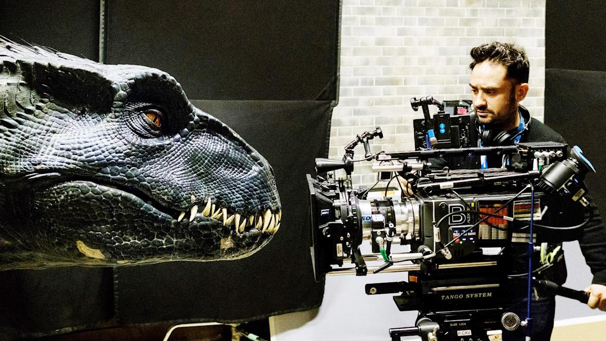 """Director J.A. Bayona with a deadly new dinosaur, the Indoraptor. This new dinosaur hybrid is the boogeyman during an extended """"haunted house"""" sequence in <i>Jurassic World: Fallen Kingdom</i>. (Photo: Universal)"""