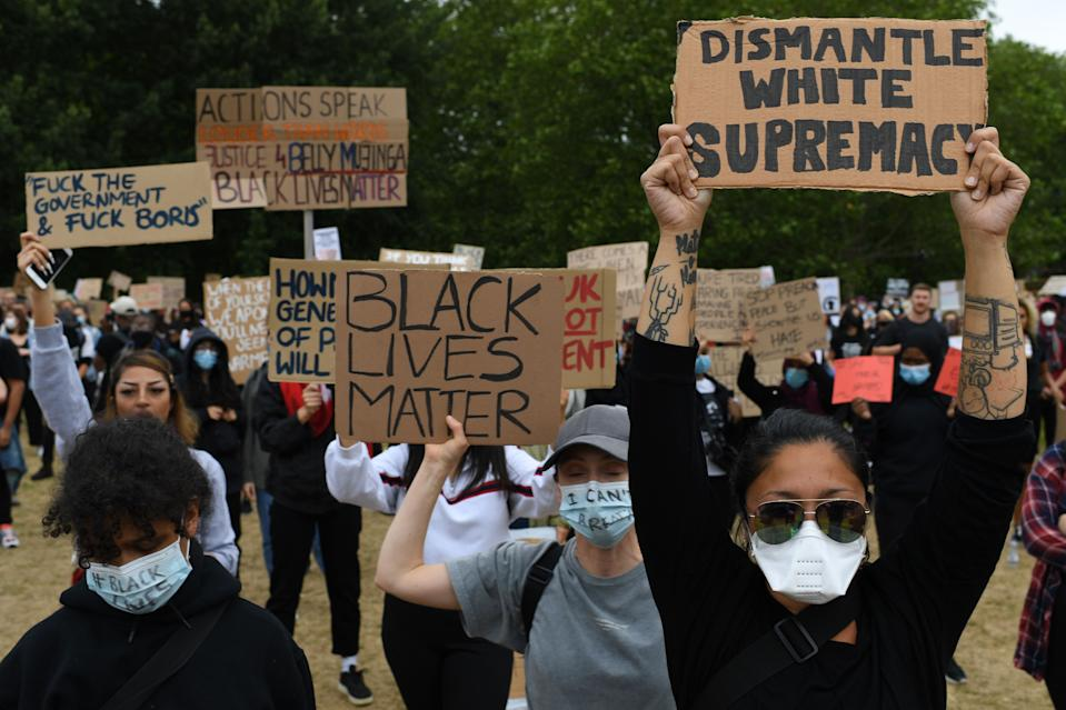 Protestors hold placards during a demonstration in London, on June 3, 2020, after George Floyd, an unarmed black man died after a police officer knelt on his neck during an arrest in Minneapolis, USA. - Londoners defied coronavirus restrictions and rallied on Wednesday in solidarity with protests raging across the United States over the death of George Floyd, an unarmed black man who died during an arrest on May 25. (Photo by DANIEL LEAL-OLIVAS / AFP) (Photo by DANIEL LEAL-OLIVAS/AFP via Getty Images)