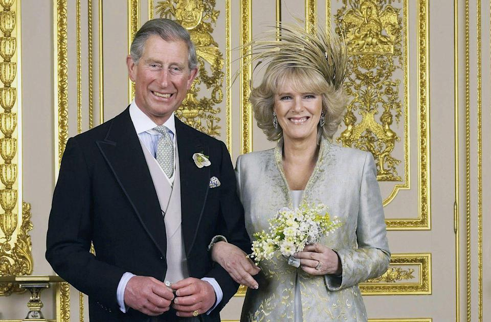 <p>Prince Charles and Camilla on their wedding day. The royal couple married in the civil ceremony at the Windsor Guildhall, which was followed by a marriage blessing at St. George's Chapel at Windsor Castle.</p>
