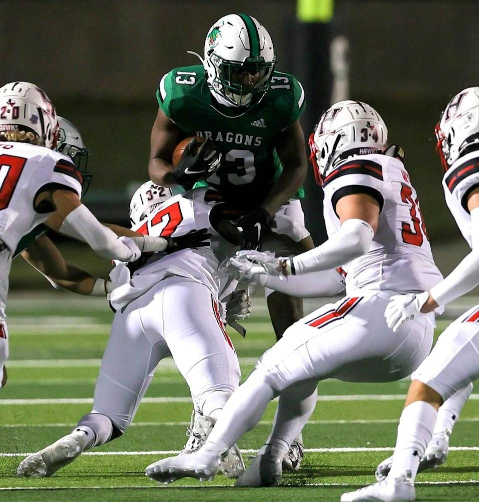 Southlake Carroll tight end RJ Maryland (13) tries to find a hole to run against Rockwall Heath during the first half of a High School Football game, Friday night, October 2, 2020 played at Dragon Stadium in Southlake, TX. (Steve Nurenberg Special to the Star-Telgram)