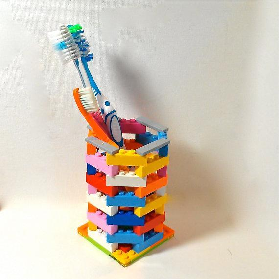 """<div class=""""caption-credit""""> Photo by: Etsy</div><div class=""""caption-title"""">LEGO Toothbrush Holder</div>This one is so simple yet so very practical! Constructing it won't take long, and its design is much cooler than that of a traditional plastic or glass toothbrush holder. <br> <i><a href=""""http://www.babble.com/mom/20-wacky-yet-practical-items-made-of-legos/?cmp=ELP bbl lp YahooShine Main  011013  20wackyyetpracticalitemsmadeoflegos famE   """" rel=""""nofollow noopener"""" target=""""_blank"""" data-ylk=""""slk:Get it from Etsy seller ValGlaser, $25"""" class=""""link rapid-noclick-resp"""">Get it from Etsy seller ValGlaser, $25</a></i>"""