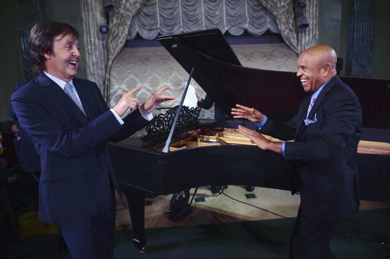 "FILE - In this Sept. 18, 2012 file photo provided by the Motown Museum, Paul McCartney, left, and Berry Gordy stand in front of a newly restored 1877 Steinway grand piano during a benefit at the Motown Museum at Steinway Hall in New York. The piano, used by Motown greats during the label's heyday, was restored with an assist by McCartney. In an April 1, 2013 news release from the museum, it was announced that the famed 9-foot piano has been returned to Detroit and will go back on display at the Motown museum's famed Studio A in the ""Hitsville, U.S.A.,"" building. (AP Photo/Motown Museum, Shahar Azran, File) MANDATORY CREDIT"