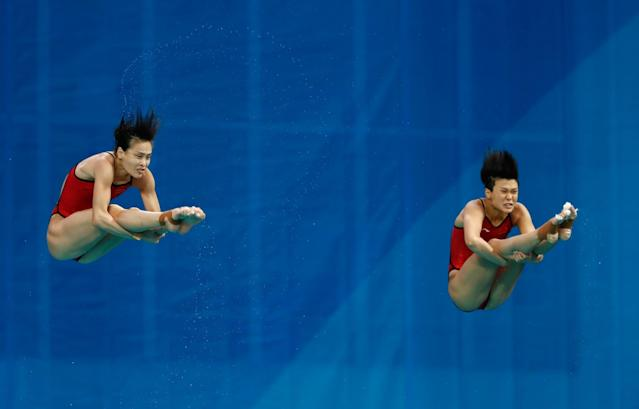 <p>Tingmao Shi and Minxia Wu of China compete in the Women's Diving Synchronised 3m Springboard Final on Day 2 of the Rio 2016 Olympic Games at Maria Lenk Aquatics Centre on August 7, 2016 in Rio de Janeiro, Brazil. (Photo by Clive Rose/Getty Images) </p>
