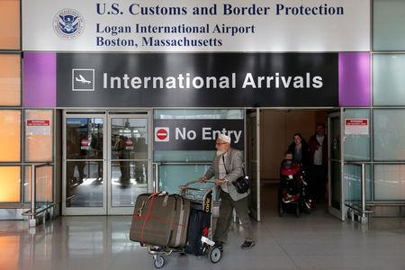 International travelers arrive after U.S. President Donald Trump's executive order travel ban at Logan Airport in Boston