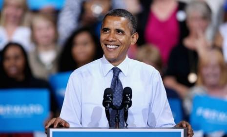 President Obama speaks during a campaign event in Fairfax, Va.: Obama and the Democrats raised are on track to raise $1 billion for the 2012 re-election campaign.
