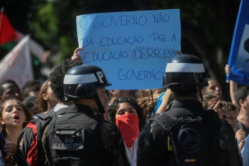 Students protest budget cuts to public education as President Jair Bolsonaro attends an anniversary ceremony at a Rio de Janeiro military school