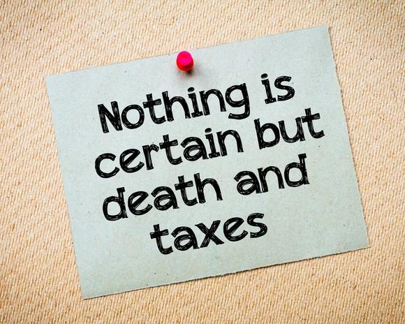 """Pinned notecard reading """"Nothing is certain but death and taxes"""""""