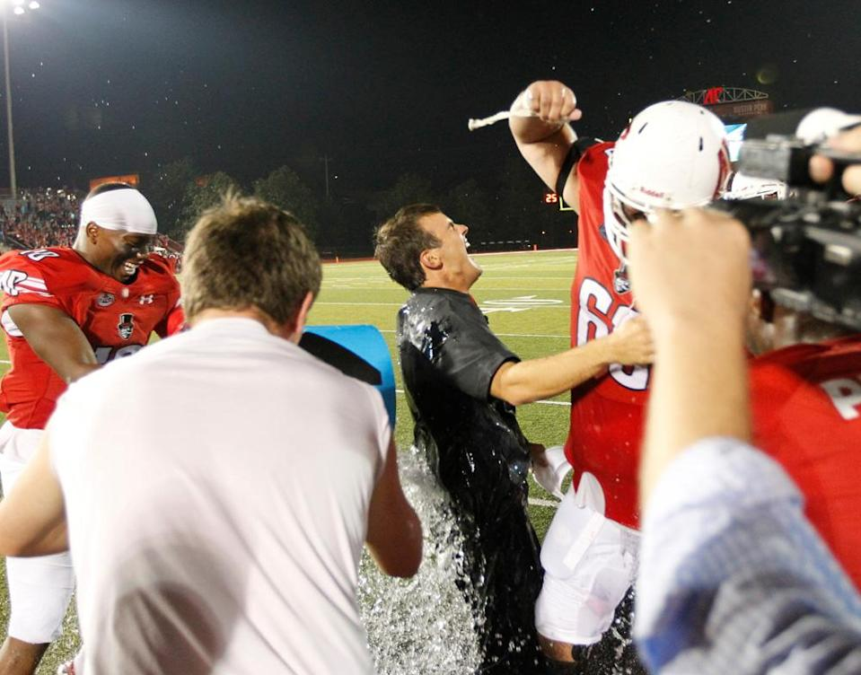 Austin Peay coach Will Healy got doused by his players after their losing streak was snapped in a win over Morehead State in 2017.(Robert Smith/Austin Peay)