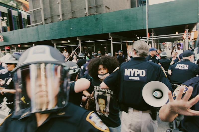 Ria Foye as she is arrested in Times Square after peacefully marching from Harlem on May 30. She was detained for more than seven hours. | Mark Clennon