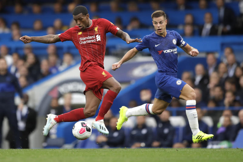 Liverpool's Georginio Wijnaldum, left, and Chelsea's Cesar Azpilicueta compete for the ball during the British premier League soccer match between Chelsea and Liverpool, at the Stamford Bridge Stadium, London, Sunday, Sept. 22, 2019. (AP Photo/Matt Dunham)