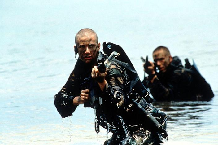 "<p>The icon paved the way for future badass women when she took on the challenge to portray real-life Navy SEAL Lieutenant Jordan O'Neill in 1997's <em>G.I. Jane</em>. Not only did she shave her head for the role, she restricted her diet to only high-protein, high-calorie food and participated in <a href=""https://www.popworkouts.com/demi-moore-workout-gi-jane/"" rel=""nofollow noopener"" target=""_blank"" data-ylk=""slk:intensive military training"" class=""link rapid-noclick-resp"">intensive military training</a>.</p>"