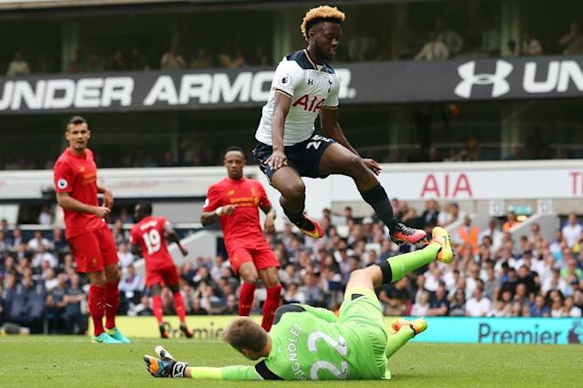 Liverpool's Belgian goalkeeper Simon Mignolet (down) blocks Tottenham Hotspur's English midfielder Joshua Onomah during the English Premier League football match at White Hart Lane in London, on August 27, 2016 (AFP Photo/Justin Tallis)
