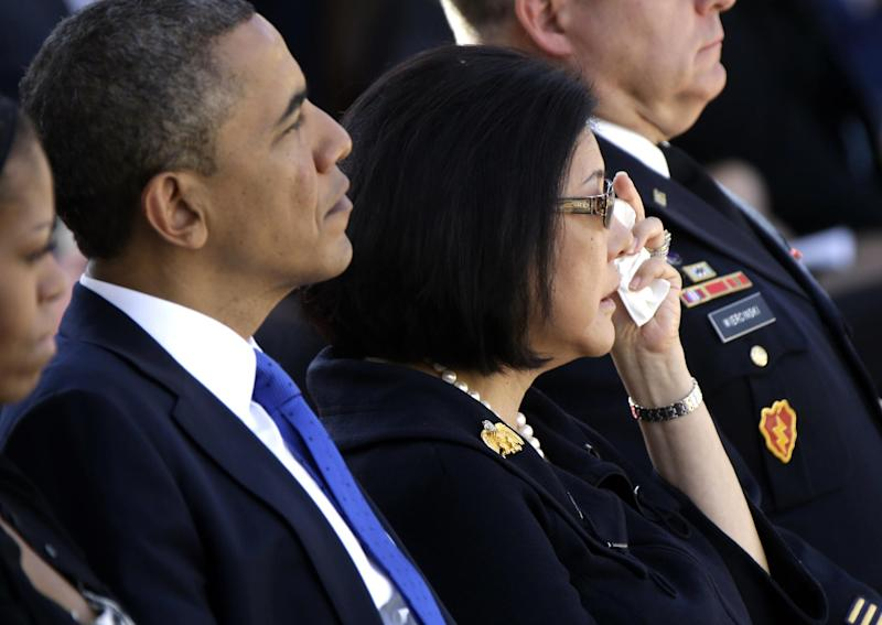 Irene Inouye, widow Sen. Daniel Inouye, D-Hawaii, wipes her eyes as she sits with President Barack Obama and first lady Michelle Obama at a Memorial Service for Sen. Inouye at the Punchbowl National Memorial Cemetery of the Pacific in Honolulu, Sunday, Dec. 23, 2012. (AP Photo/Gerald Herbert)