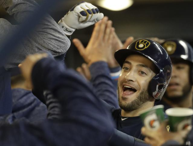 Milwaukee Brewers' Ryan Braun reacts after hitting a three-run hime run during the sixth inning of a baseball game against the Miami Marlins Thursday, April 19, 2018, in Milwaukee. (AP Photo/Morry Gash)