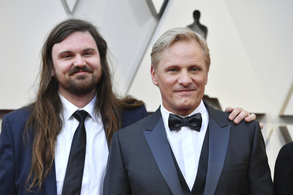 Henry Mortensen, left, and Viggo Mortensen arrives at the Oscars on Sunday, Feb. 24, 2019, at the Dolby Theatre in Los Angeles. (Photo by Jordan Strauss/Invision/AP)