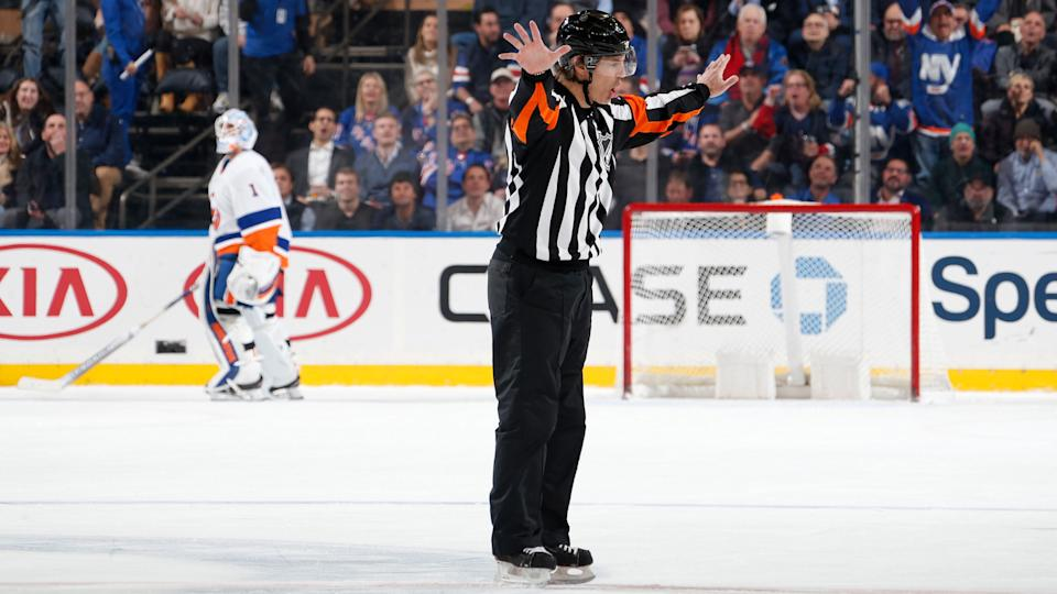 NEW YORK, NY - JANUARY 21:  Referee Wes McCauley overturns a goal by the New York Rangers in the second period for offsides against the New York Islanders at Madison Square Garden on January 21, 2020 in New York City. (Photo by Jared Silber/NHLI via Getty Images)