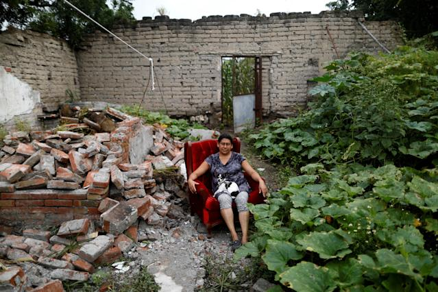 "<p>Teresa Luna, 49, a seamstress, poses for a portrait with her dog Dokie, next to part of her house which was badly damaged after an earthquake in Chietla, Mexico, September 28, 2017. With the help of her family Luna was able to rescue some furniture. ""The most valuable thing that I recovered was my dog,"" Luna said. She is living in her backyard and hopes to return when the damage is repaired. (Photo: Edgard Garrido/Reuters) </p>"