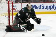 Arizona Coyotes goaltender Darcy Kuemper makes a save against the Minnesota Wild during the second period of an NHL hockey game Wednesday, April 21, 2021, in Glendale, Ariz. (AP Photo/Ross D. Franklin)