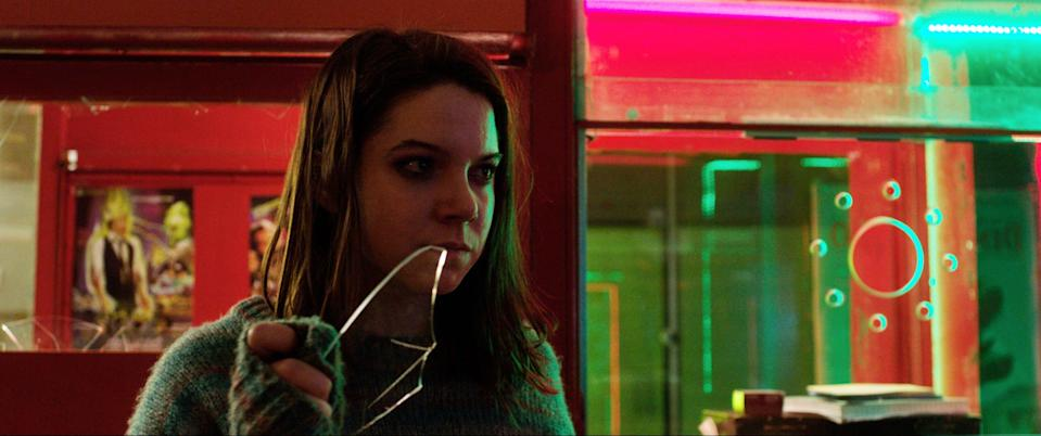 """An audience attending a scary movie in a cinema is killed one by one by a mystery man, and the only person who notices is the projectionist's daughter (Luciana Grasso) in """"The Last Matinee."""""""